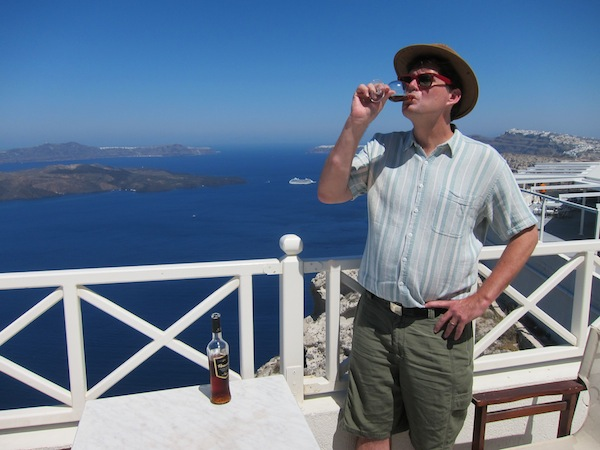The author, drinking wine in Santorini