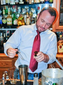 Jason Withrow, bar manager of REDD, adds a special tincture to a custom cocktail. (photo: David Bennion, used with permission)