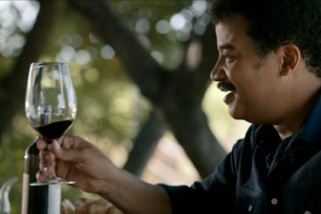 "Neil DeGrasse Tyson enjoys a glass of wine on a recent episode of ""Cosmos"""