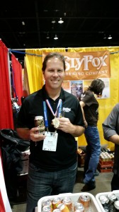 Brian O'Reilly shows off his gold medal and silver can at the 2014 Great American Beer Festival