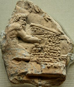 First century C.E. relief of a satyr working with grapes and wicker mats