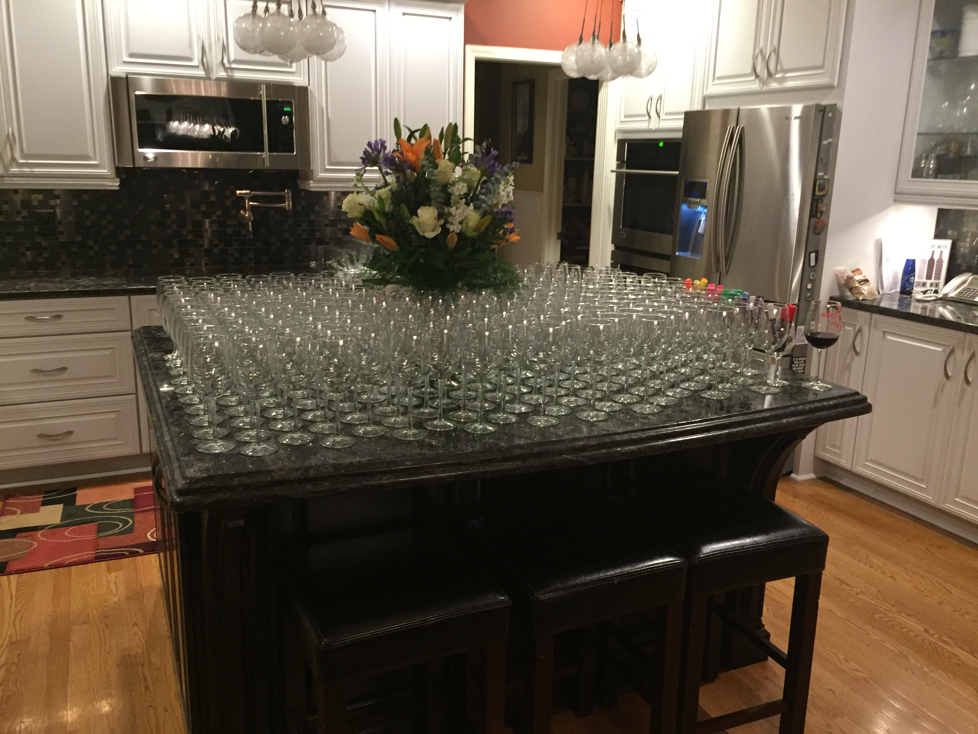 150 wine glasses, waiting for guests to arrive